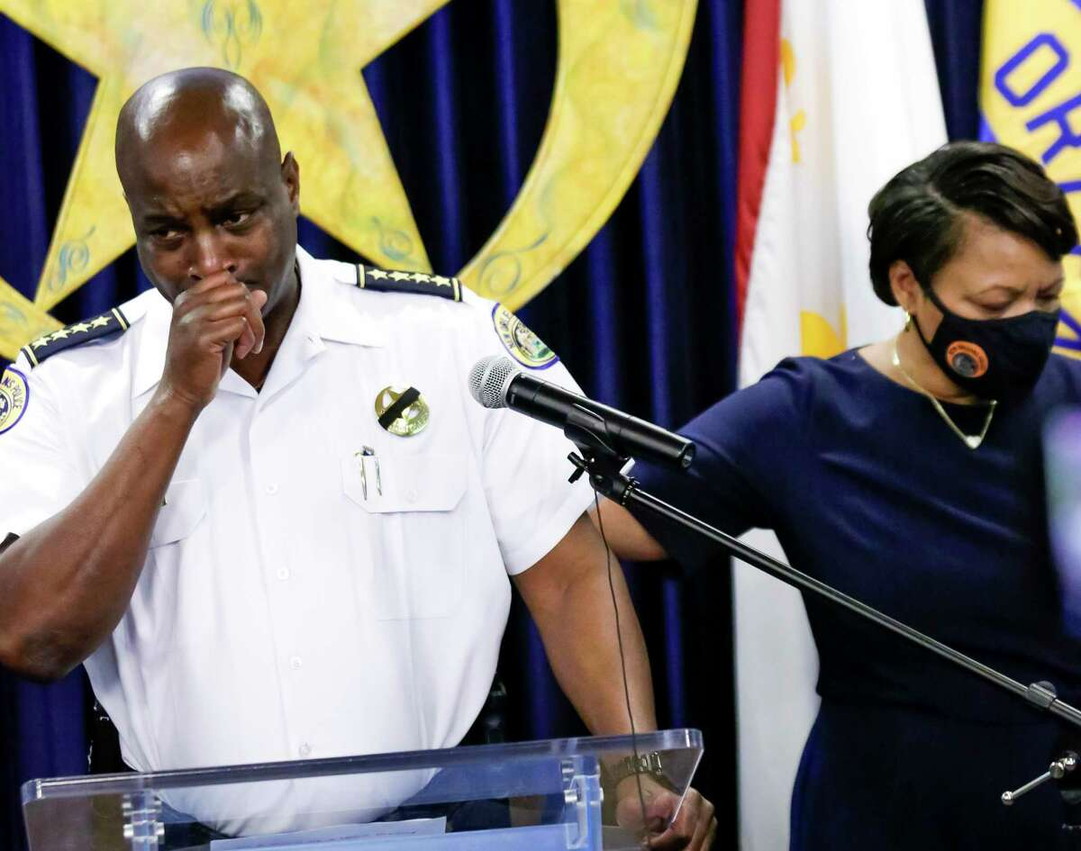 Mayor LaToya Cantrell, right, comforts New Orleans Police Department Superintendent Shaun Ferguson during a news conference, Sunday, Aug. 22, 2021, in New Orleans, to announce the death of Officer Everett Briscoe, who was fatally shot Saturday at a restaurant in Houston. (Scott Threlkeld/The Times-Picayune/The New Orleans Advocate via AP)