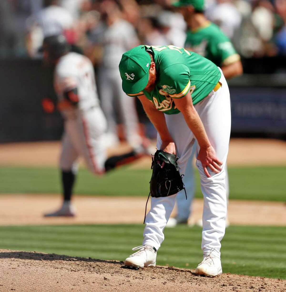 Oakland Athletics' reliever AJ Puk reacts to giving up go-ahead 2-run home run to San Francisco Giants' Donovan Solano in 8th inning during MLB game at Oakland Coliseum in Oakland, Calif., on Sunday, August 22, 2021.