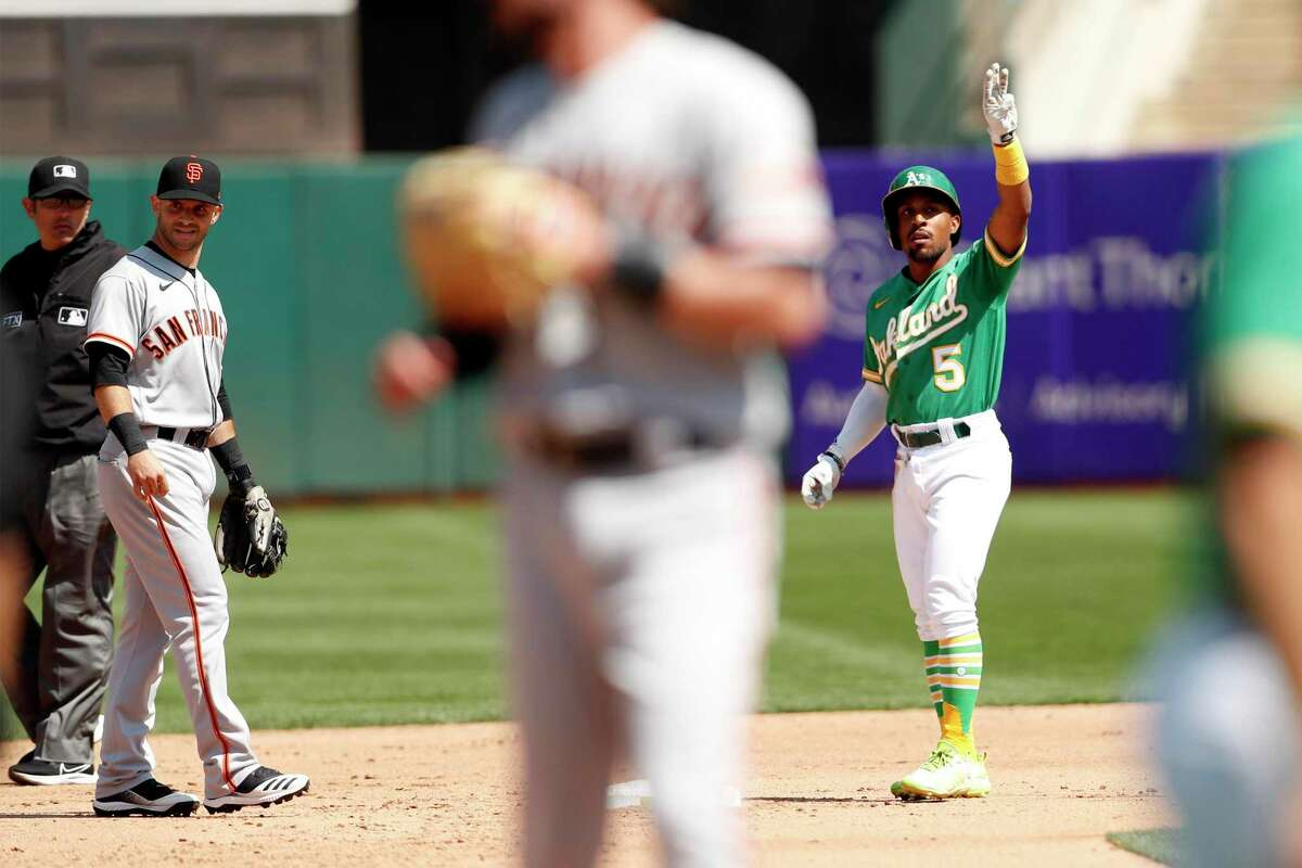 Oakland Athletics' Tony Kemp signals to dugout after doubling in 6th inning against San Francisco Giants' Logan Webb during MLB game at Oakland Coliseum in Oakland, Calif., on Sunday, August 22, 2021.