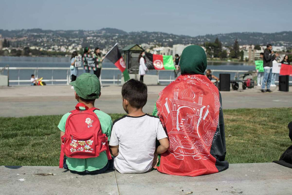 Protesters at Lake Merritt in Oakland rally in support of Afghans.