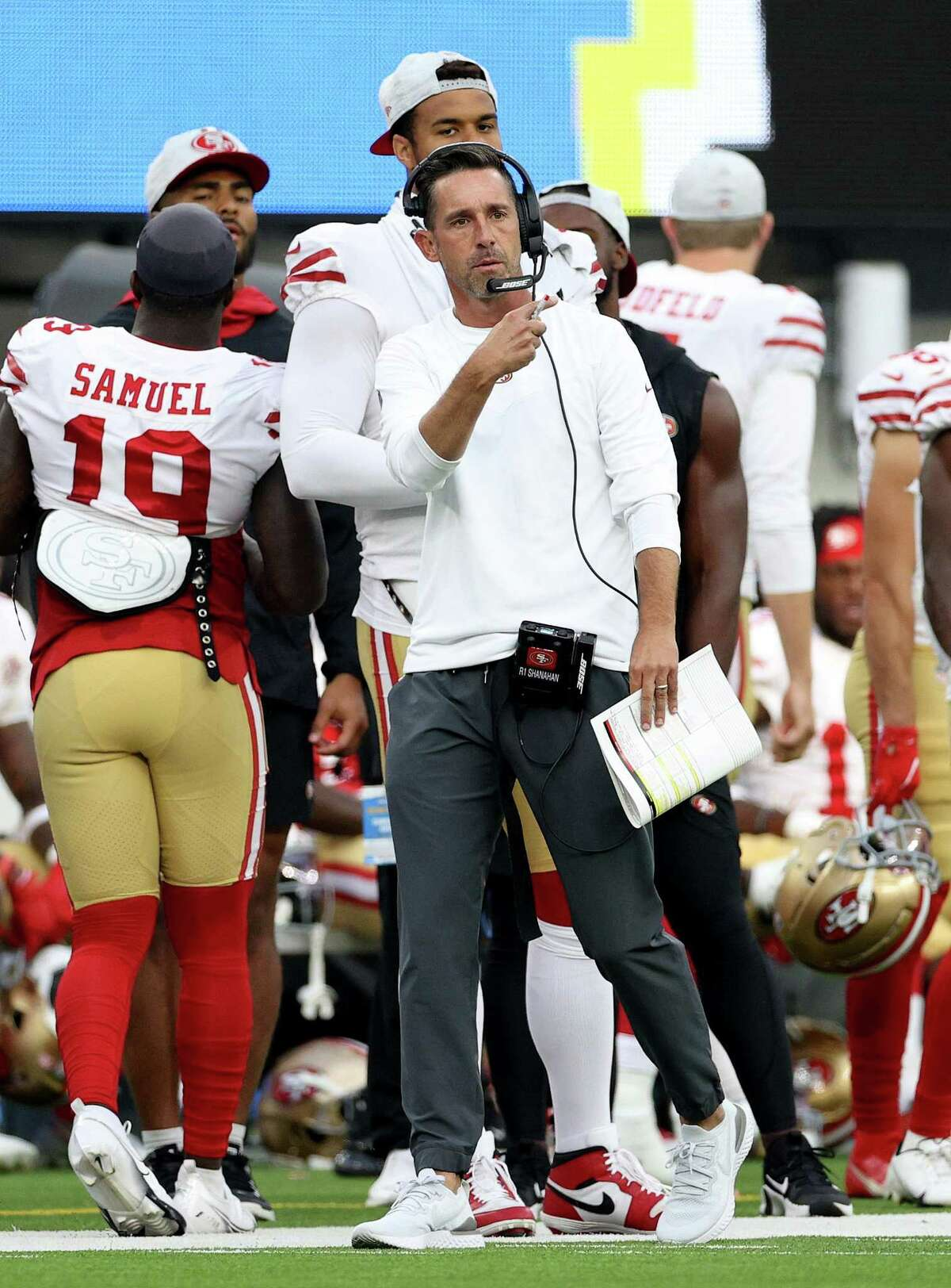 INGLEWOOD, CALIFORNIA - AUGUST 22: Head coach Kyle Shanahan of the San Francisco 49ers on the sidelines during the first half of a preseason game between the Los Angeles Chargers and the San Francisco 49ers at SoFi Stadium on August 22, 2021 in Inglewood, California. (Photo by Harry How/Getty Images)
