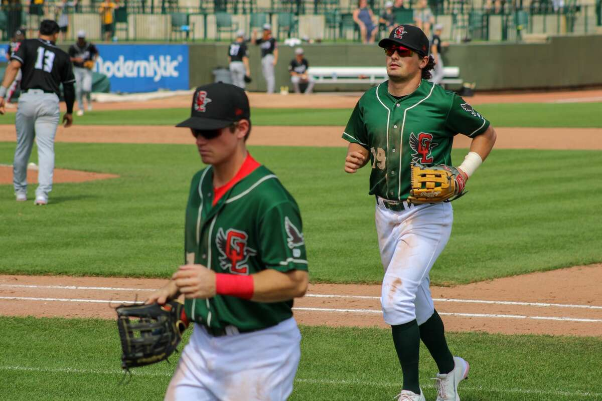 Loons outfielders Joe Vranesh (right) and Jonny DeLuca (left) jog off the field against Lansing on Aug. 22 at Dow Diamond