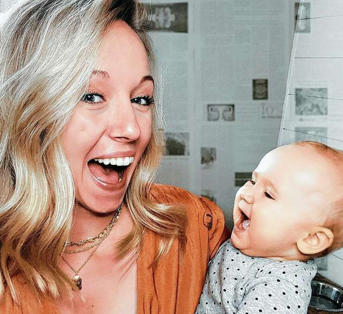 TikTok creator Hayley Wombles holds 10-month-old Madilyn. Wombles has accumulated more than 400,000 followers on the social media platform, particularly for her advice video on motherhood.