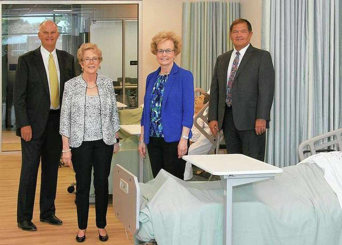 Ken Elmore (from left), Charlotte Warren, Marsha Prater and Ed Curtis discuss the features of a lab in the new Lincoln Land Community College Nursing Education Center, which opened Friday.