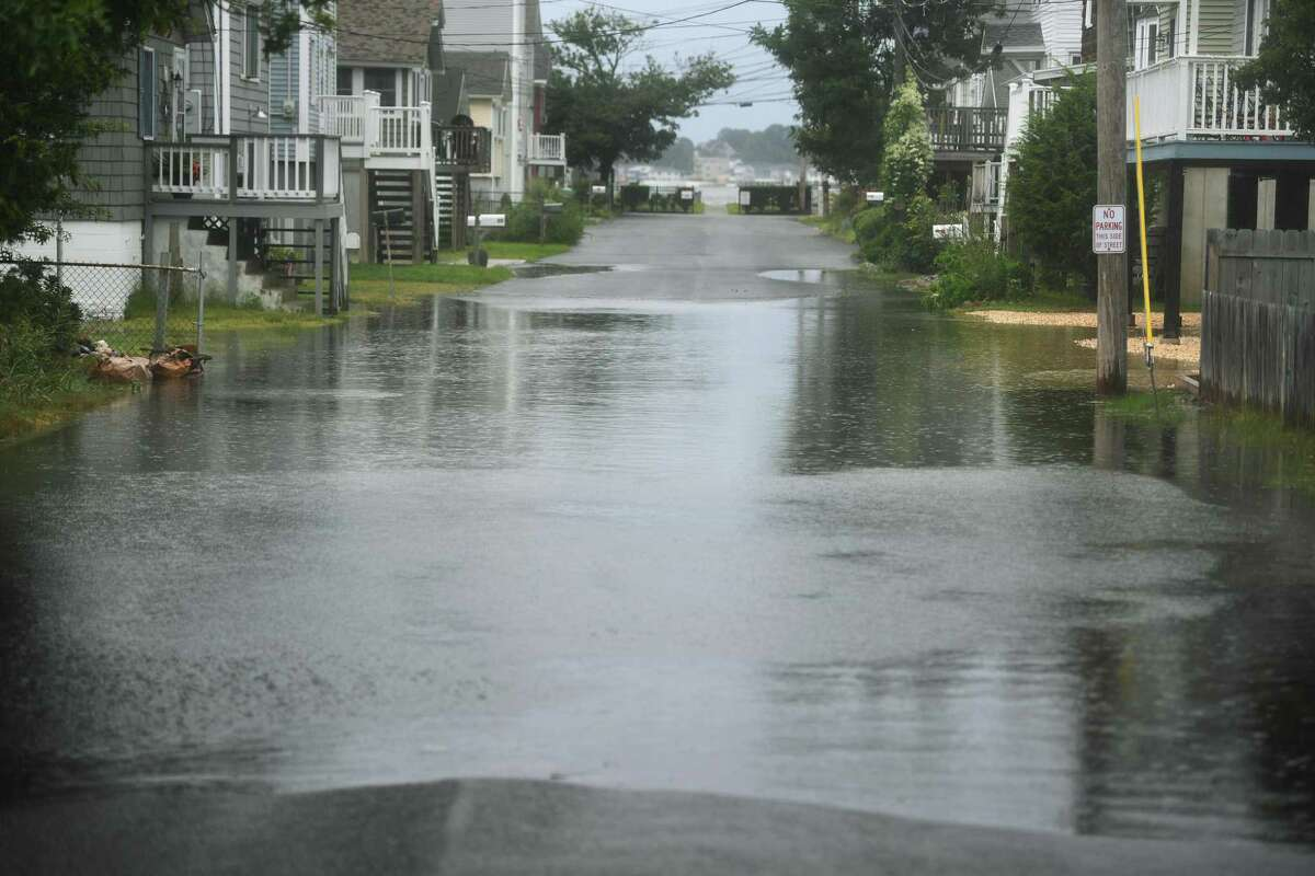A low lying section of Richard Street is flooded during rains from Tropical Storm Henri in Milford, Conn. on Sunday, August 22, 2021.