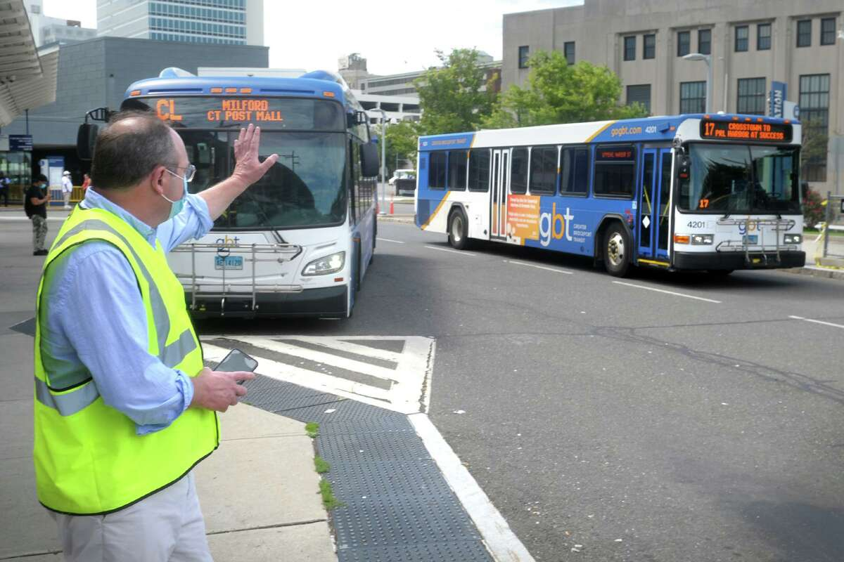 Doug Holcomb, CEO of Greater Bridgeport Transit (GBT), waves to a passing bus during an interview at the Bridgeport Transit Center, in Bridgeport, Conn. Sept. 3, 2020.
