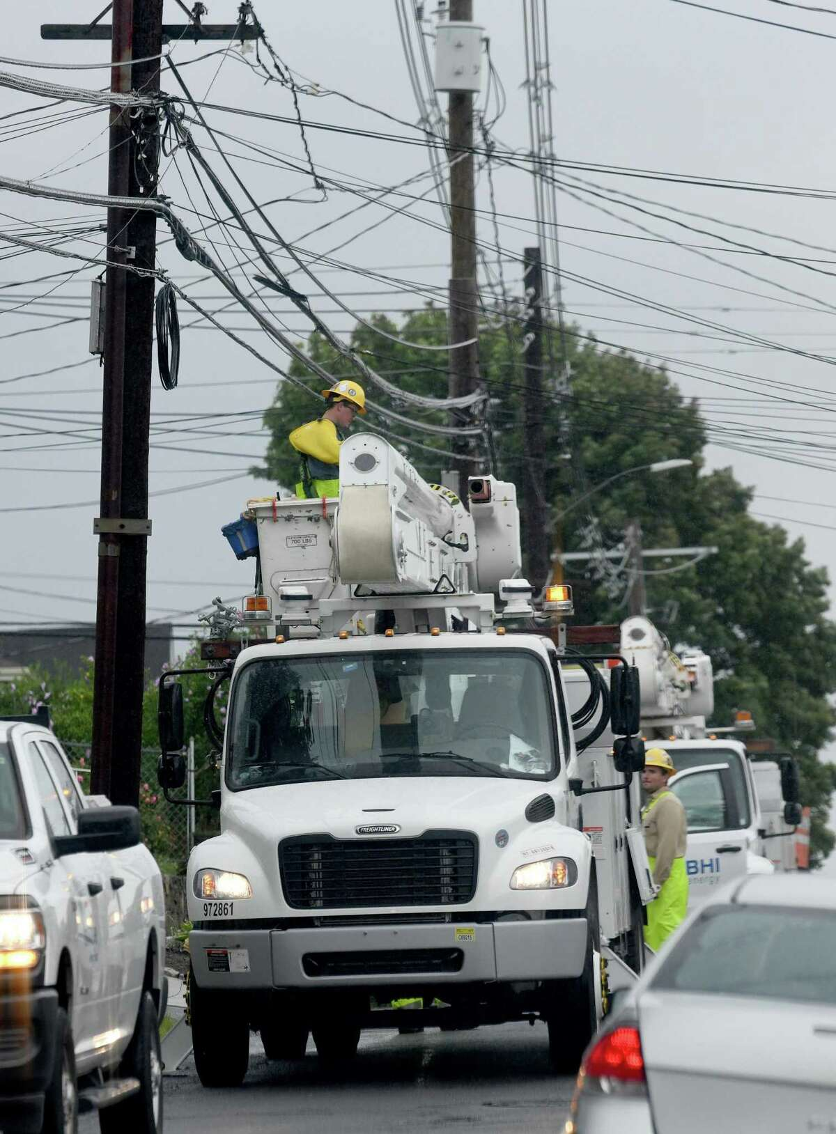 Power company crews work on Town Hill Avenue in Danbury Sunday, August 22, 2021, to restore power to residents effected by Tropical Storm Henri.