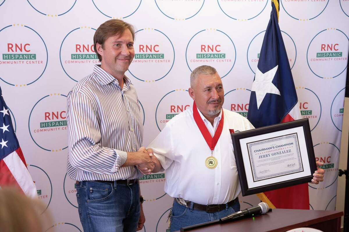 RNC Co-Chairman Tommy Hicks introduces award for Chairman's Champion to Jerry Gonzalez inside the new RNC Hispanicy Engagement Office on Aug. 21.