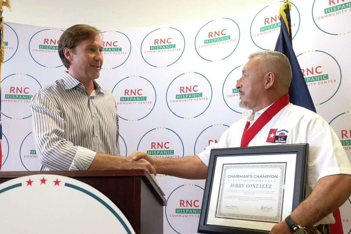 RNC Co-Chairman Tommy Hicks introduces Chairman's Champion award to Jerry Gonzalez at the RNC Hispanic Engagement Office on Aug. 21.