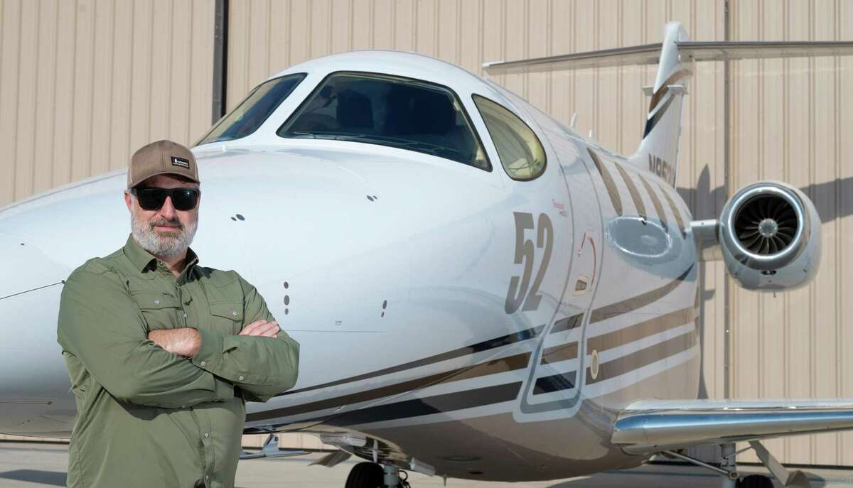 Rio Grande Helicopters Pilot Spencer Morgan poses for a feature photo Thursday, Aug. 19, 2021, at the Laredo International Airport with the plane he used to win the 23 Annual AirVenture Cup Race.