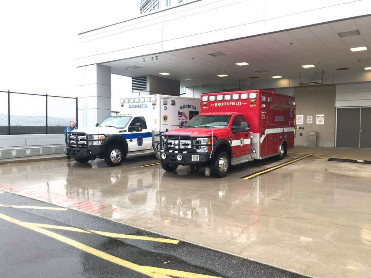 Brookfield paramedics helped transport two patients to Danbury Hospital after a crash on Route 202 in Washington, Conn., on Sunday, Aug. 22, 2021.