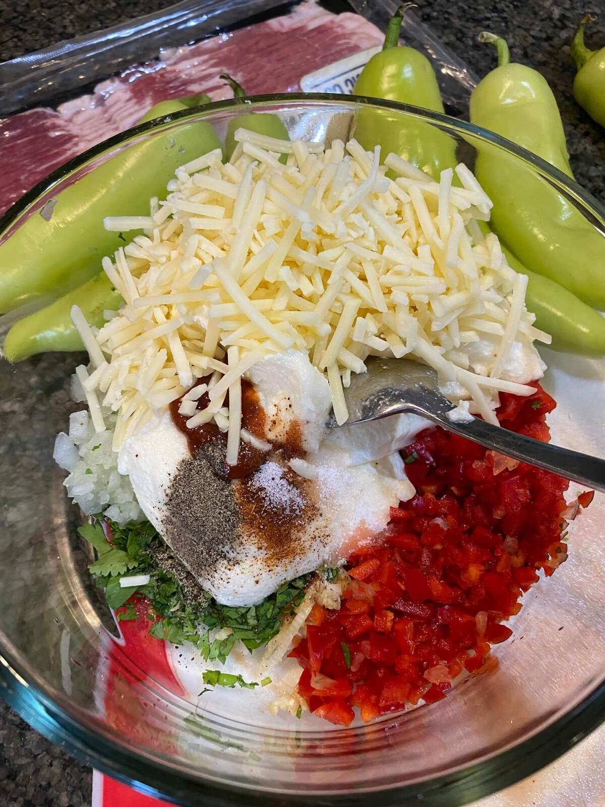 The ricotta mixture includes onion, garlic, bell pepper, sriracha, herbs and spices.