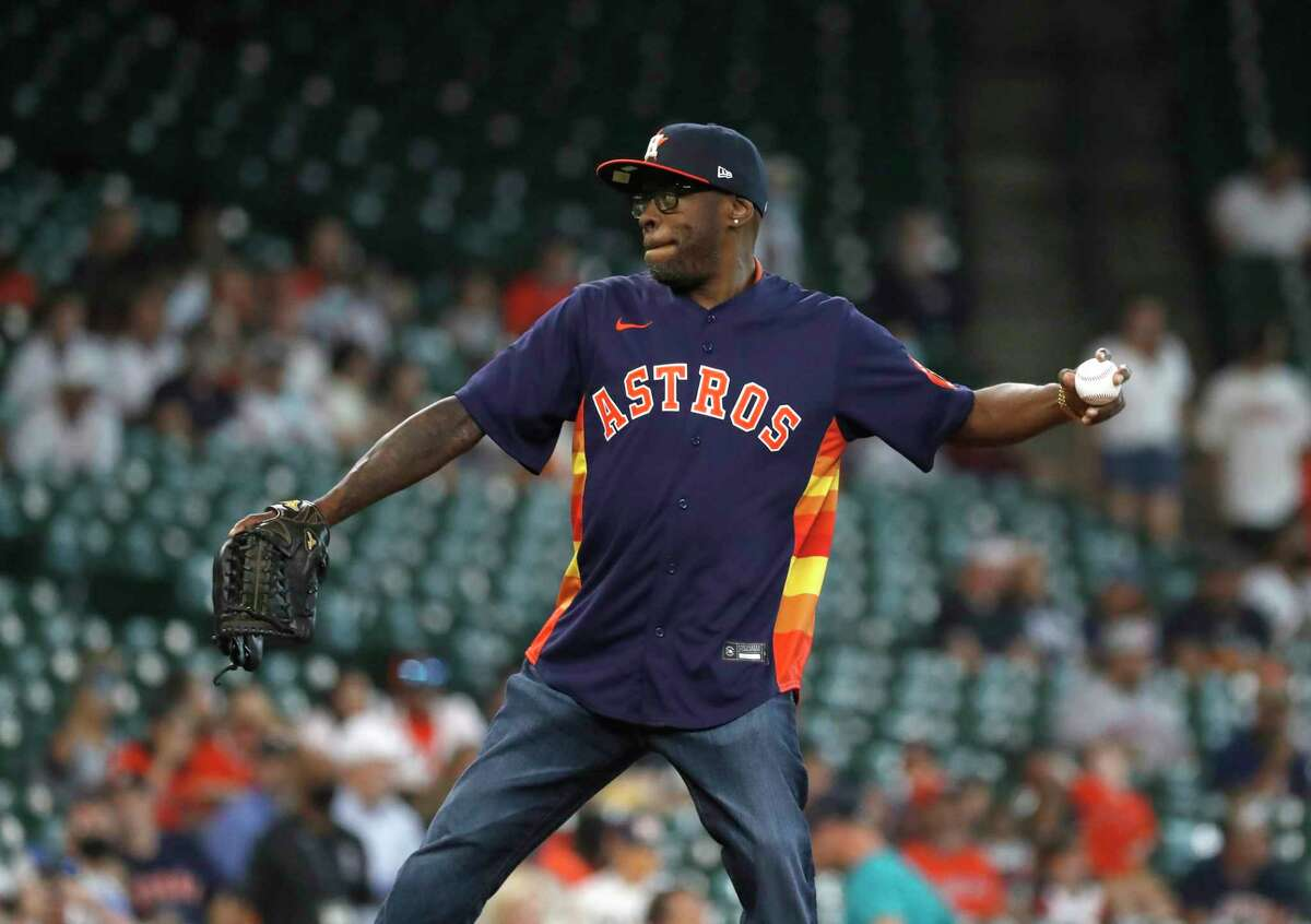 Rapper Scarface throws out the first pitch before the start of the first inning of an MLB baseball game at Minute Maid Park, Sunday, August 22, 2021, in Houston.