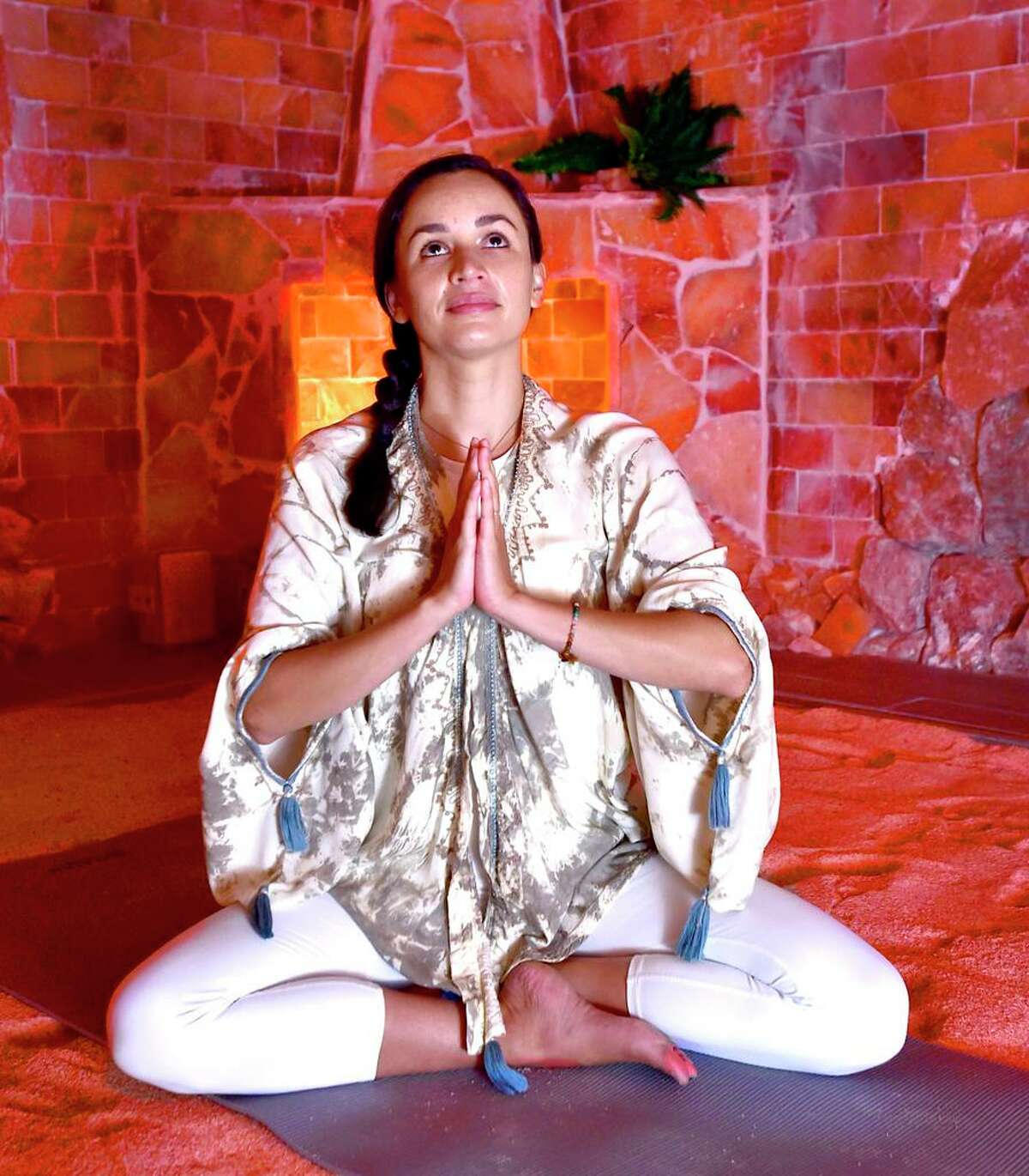 Erin Schuster leads yoga sessions at the Healing Salt Cave and Wellness Spa in Guilford.