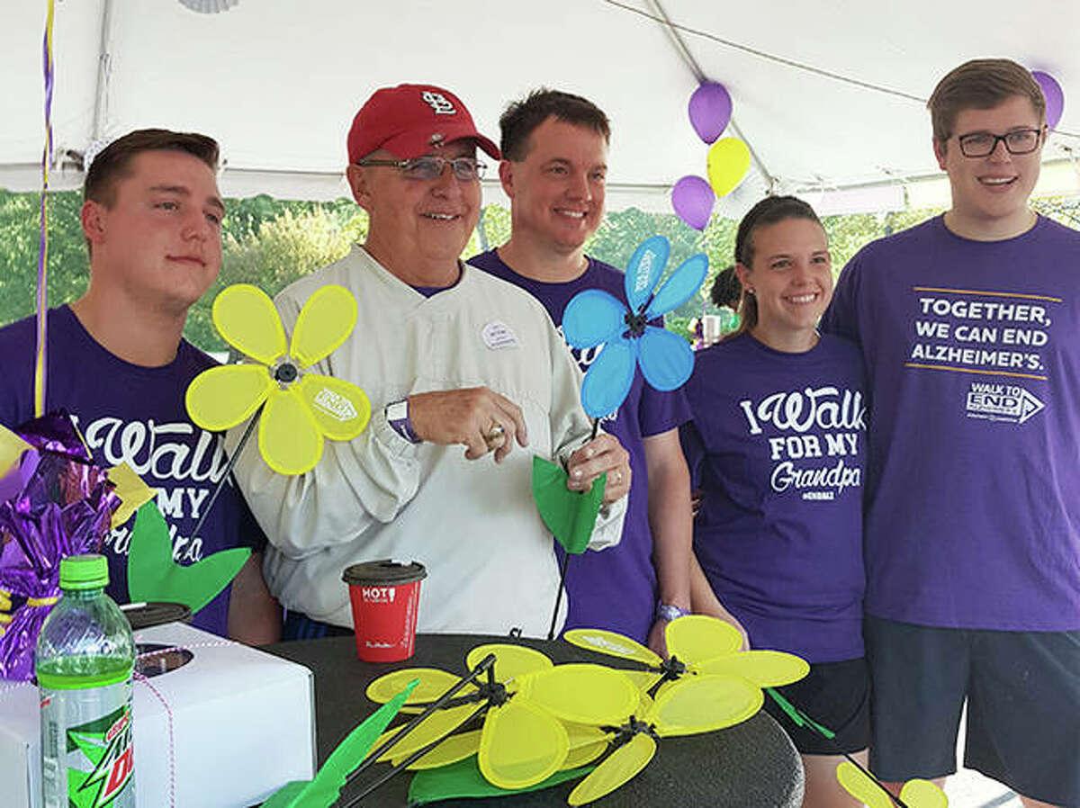 Left to right, Brent Heinlein, John Ostanik, Scott Heinlein, Hilary Himmelberg and Jon Himmelberg at the 2017 Walk to End Alzheimer's in Edwardsville. Ostanik died from Alzheimer's on Feb. 17, 2021.