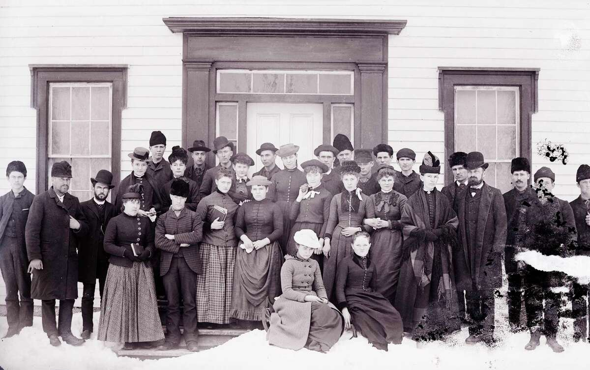 Group portrait of students and faculty taken in front of East Hall, Benzonia College, in 1890. (Courtesy Photo)
