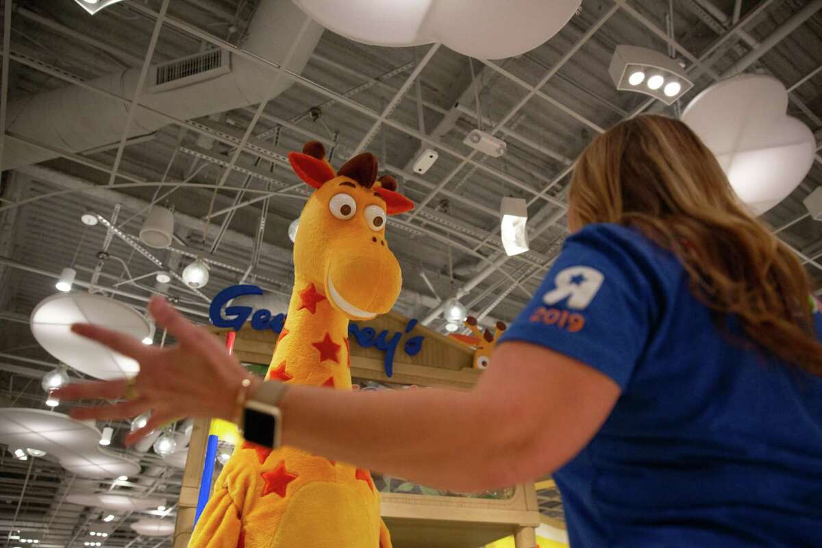 A Geoffrey the Giraffe mascot in 2019 at the Houston Galleria mall in Houston, where Toys R Us made a brief comeback along with a store in Paramus, N.J. Under new owner WHP Global, the brand is making a retail comeback insider many Macy's department stores nationally.