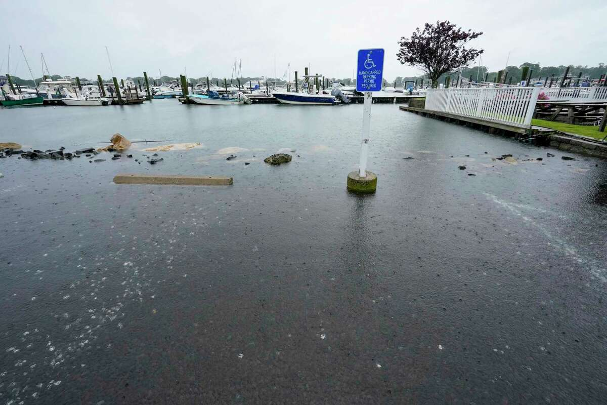 The parking lot of a marina is flooded during high tide, Sunday in Branford, as Tropical Storm Henri affected the Atlantic coast.