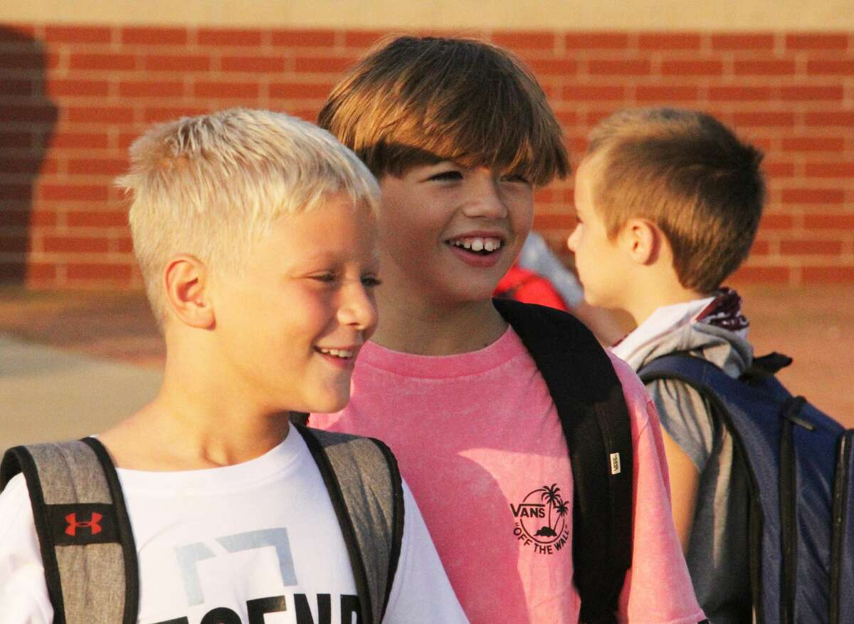 There were lots of smiling faces and happy reunions on Monday morning as kids in Cass City headed back to class for the first day of the new school year.Most school districts in the Upper Thumb will hold their first day of classes next week.