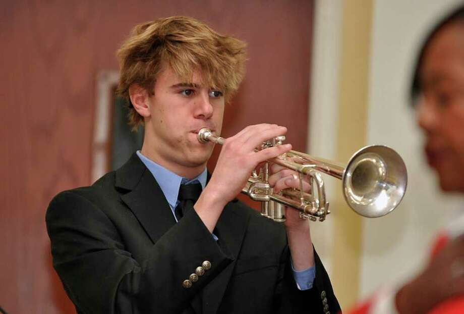 Cameron Bruce, of the Staples High Buglars, plays Taps during the Veterans Day Services at Town Hall on Wednesday, Nov. 11, 2009. Photo: Amy Mortensen / Connecticut Post Freelance