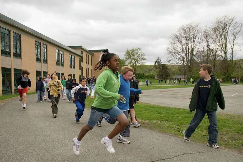 Students walk around the track at Sarah Noble Intermediate School in New Milford Wednesday during the start of their annual Walking Project. Photo: Max Steinmetz / The News-Times Freelance