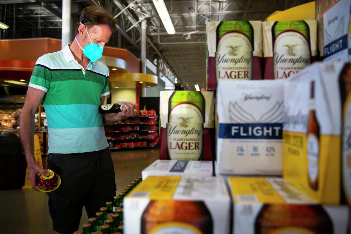 David West checks out the brand new Yuengling display as the beer makes its Houston debut at the H-E-B in Montrose on Monday, Aug. 23, 2021.