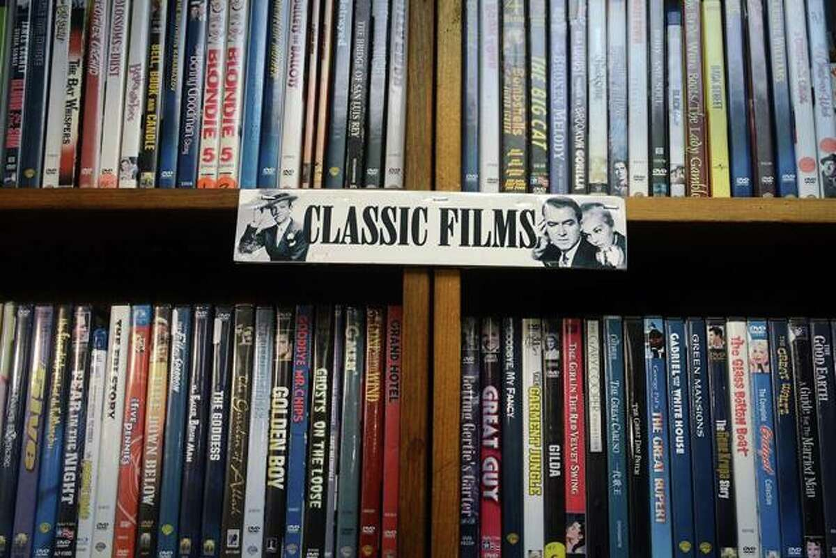 A wall of classic films at Best Video Film & Video Cultural Center, in Hamden, Conn.