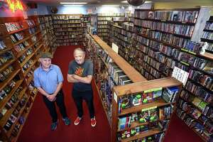 Hank Hoffman, left, and Hank Paper pose at Best Video Film & Video Cultural Center, in Hamden, Conn. July 29, 2021. Hoffman is the current director of Best Video. Paper founded Best Video in 1985.