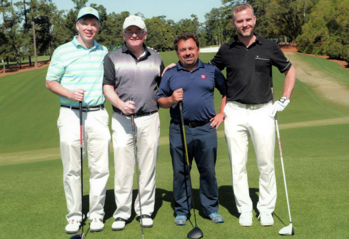 Pete Dougherty, second from left, plays at Augusta National following the 2017 Masters Golf Tournament, April 2017, in Augusta Ga. (Provided)