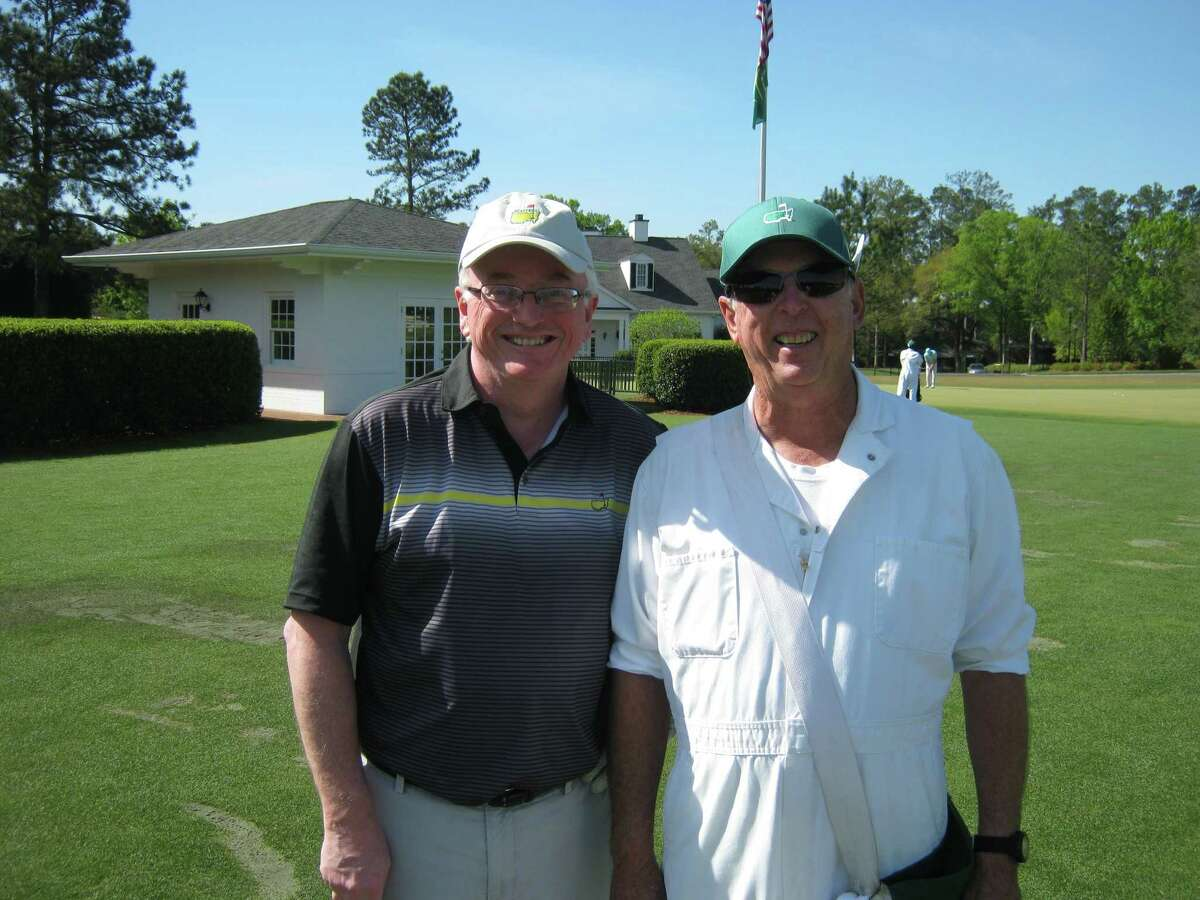 Times Union golf writer Pete Dougherty, left, with his Augusta National caddie for the day, John. Monday, April 10, 2017.