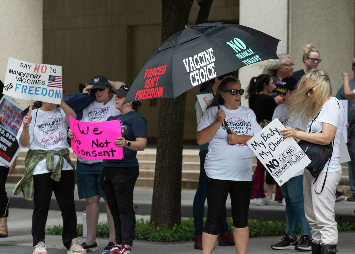 People protest against Houston Methodist Hospital requiring its employees to get COVID vaccination Saturday, May 22, 2021, at Texas Medical Center in Houston.