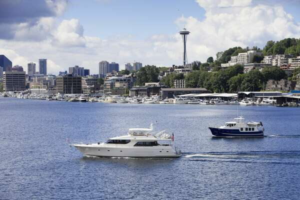 Two powerboats on Lake Union in Seattle.