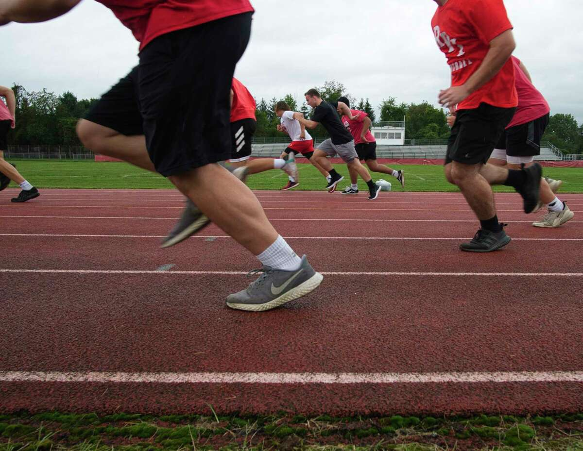 Guilderland High School varsity football players perform speed tests during the first day of football practice on Monday, Aug. 23, 2021, in Guilderland Center, N.Y.