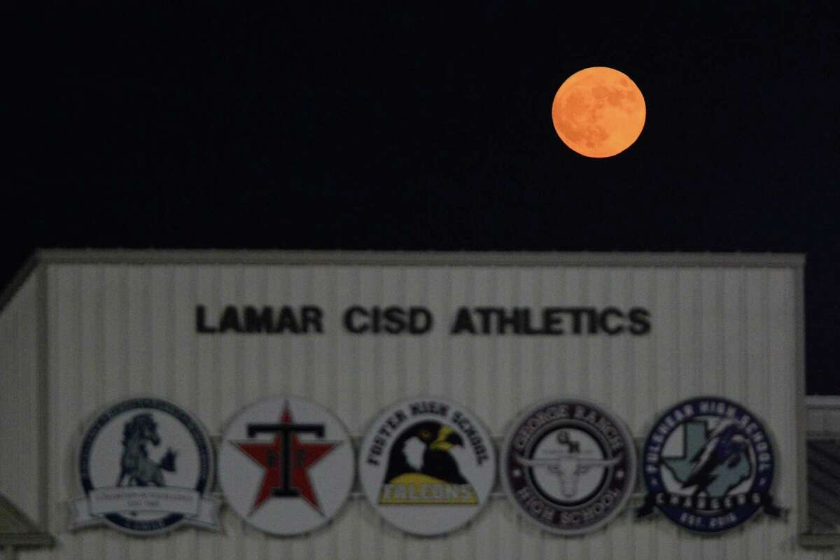 A harvest moon rises over Traylor Stadium, Rosenberg, TX on Friday, September 13, 2019.