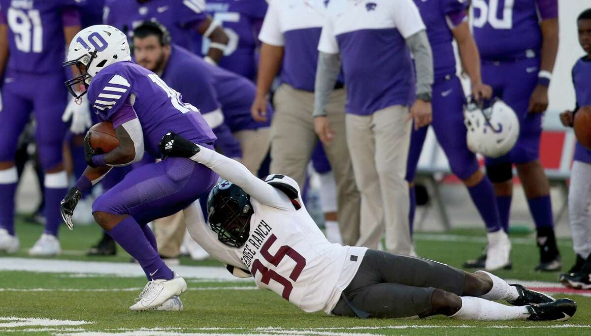 Humble Wildcats wide receiver Donald harper (10) drags George Ranch Longhorns defensive back Jeffrey Ugochukwu (35) in the first half in a high school playoff football game on November 23, 2019 at TDECU Stadium in Houston, TX.