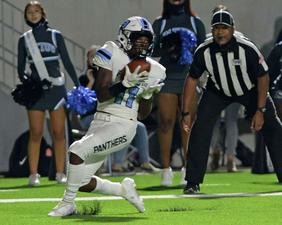 Kole Wilson (11) of Paetow makes a touchdown reception during the second half of a non-conference football game between the Paetow Panthers and the Morton Ranch Mavericks on Friday, October 2, 2020 at Legacy Stadium, Katy, TX.