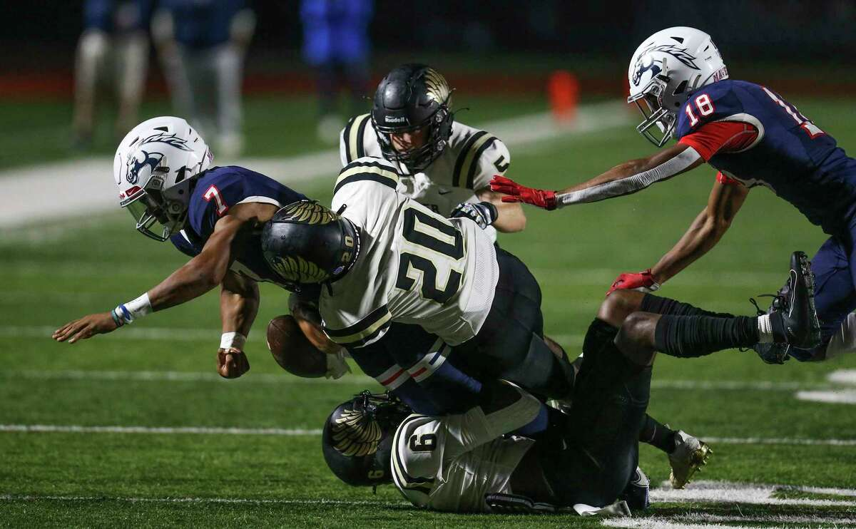 Manvel Mavericks quarterback Gabriel Larry (7) is tackled by Foster Falcons defensive back Ben Osueke (6) in the first half in a high school football game on November 13, 2020 at Alvin Memorial Stadium in Alvin, TX.
