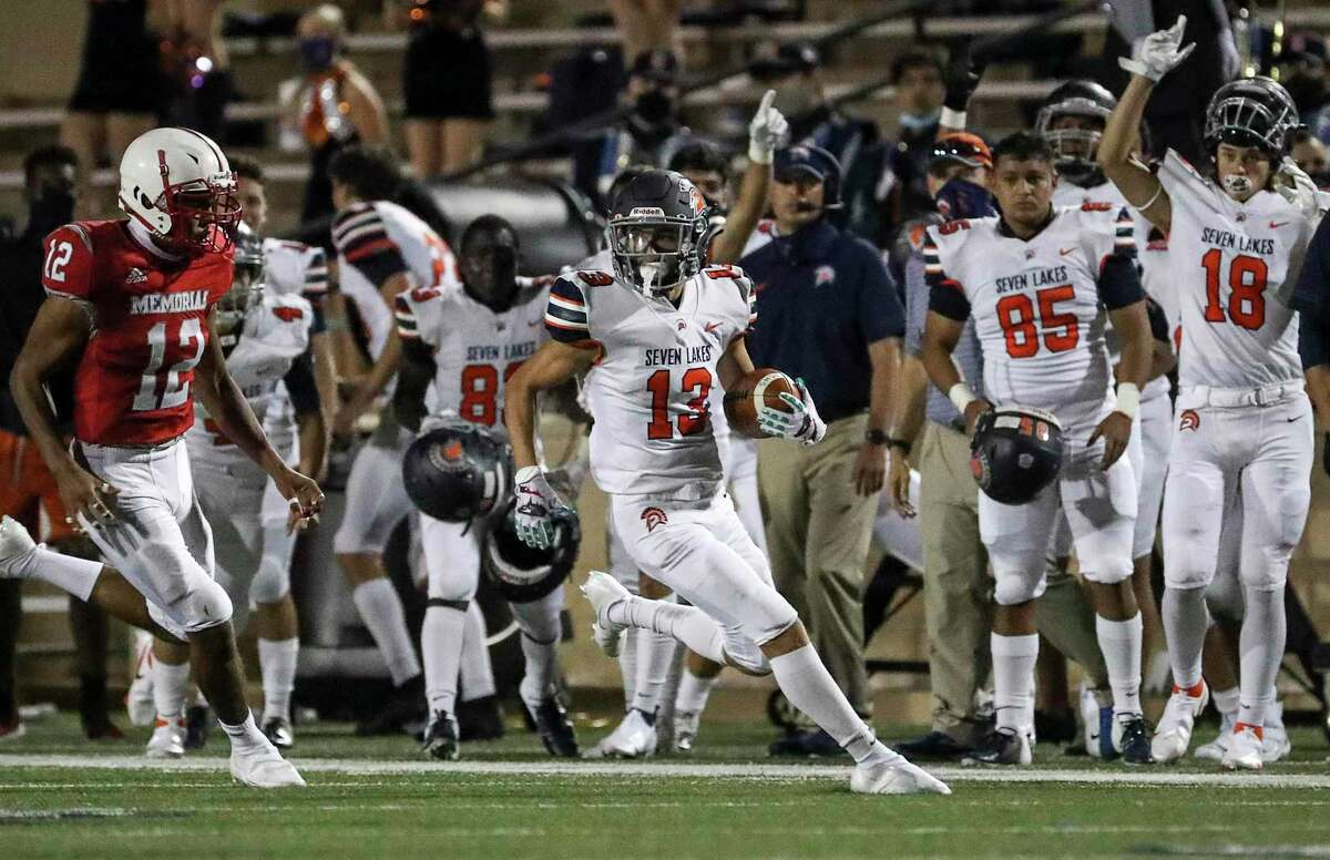 Seven Lakes Spartans wide receiver Grayson Medford (13) runs past Memorial Mustangs Candor Miller (12) during the fourth quarter of a football game Thursday, Sept. 24 2020, at Darrell Tully Stadium in Houston.