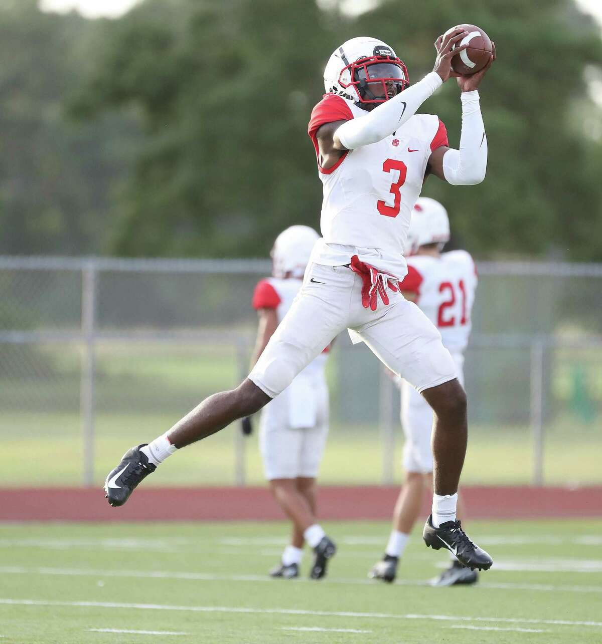Katy High School DB Bobby Taylor catches a pass in warmups before a high school football scrimmage between Katy High School and Klein Collins at Klein Collins High School, Thursday, August 19, 2021, in Spring.