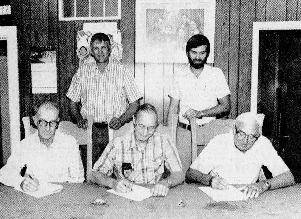 The Filer Township Hall buzzed with excitement last night as the final plan for the Magoon Creek Natural Area was signed by township officials and soil conservation district representatives. (From left, seated) Harry Taylor, Chester Pieczynski and Carl Krusniak are pictured followed by John Urka and Jim Haveman who are standing. The photo was published in the News Advocate on Aug. 25, 1981. (Manistee County Historical Museum photo)