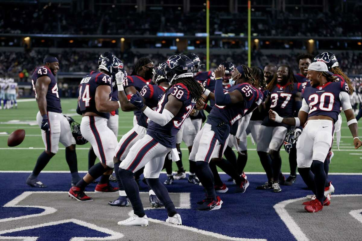 The Houston Texans defensecelebrates after an interception against the Dallas Cowboys in the second half of a preseason NFL game at AT&T Stadium on August 21, 2021 in Arlington.