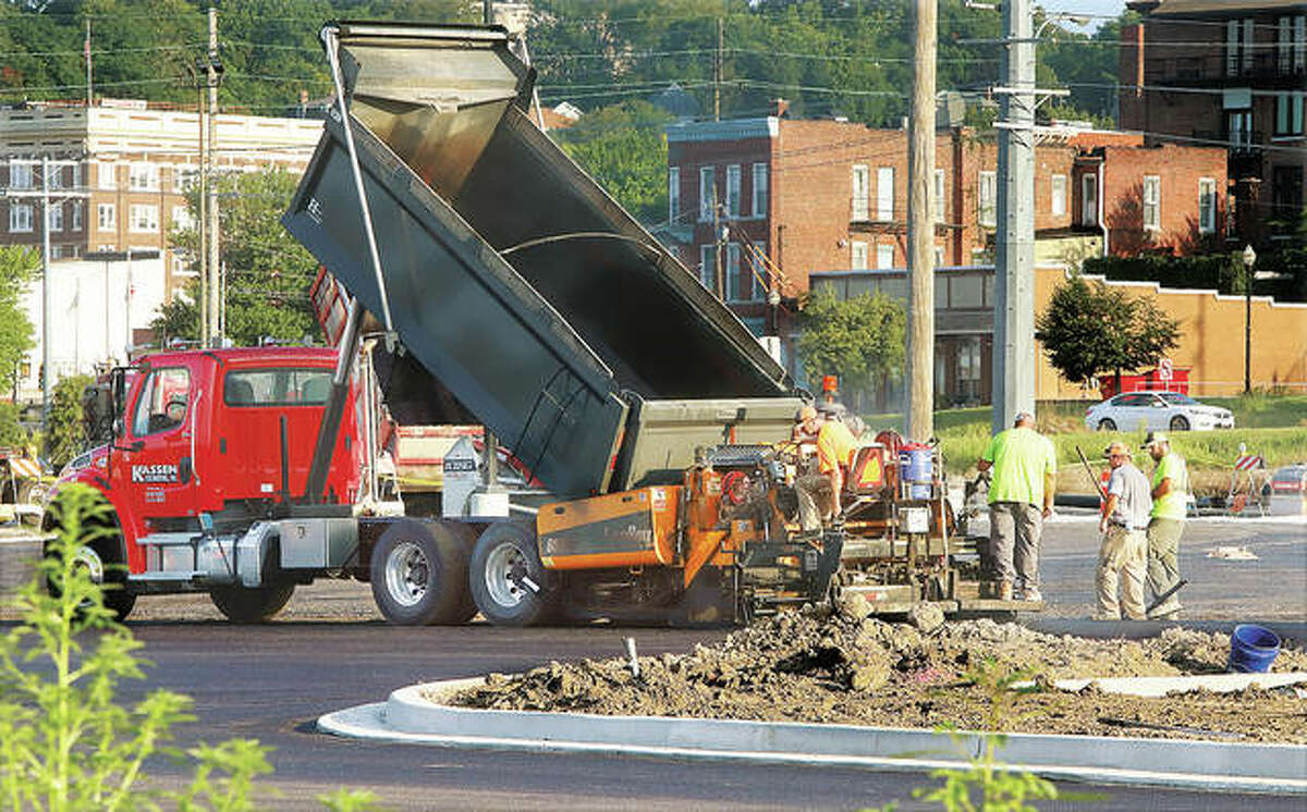 A first layer of asphalt was laid Monday in Riverfront Park. When completed the entire parking lot should be on one level.