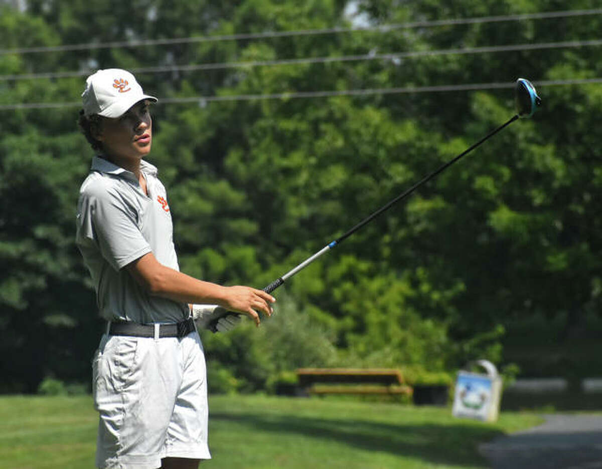 Edwardsville's Carter Crow watches his tee shot on No. 2 at Belk Park Golf Course during the Madison County Tournament on Thursday.