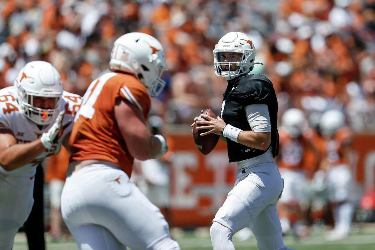 After UT's final preseason scrimmage on Saturday, coach Steve Sarkisian said he was happy with what he saw from starting quarterback contenders Hudson Card, right, and Casey Thompson.