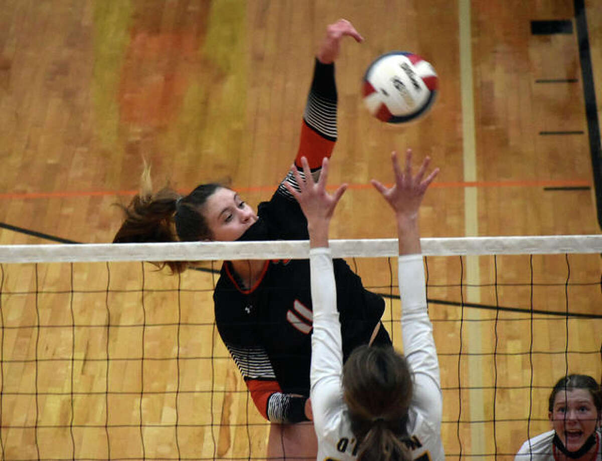 Edwardsville's Gabby Saye slams down one of her career-high 17 kills during the first game against O'Fallon in the Southwestern Conference Tournament championship match in Edwardsville.