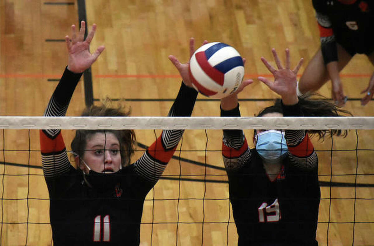 Edwardsville's Gabby Saye, left, goes up for a block during the first game against O'Fallon in the Southwestern Conference Tournament championship match in Edwardsville.
