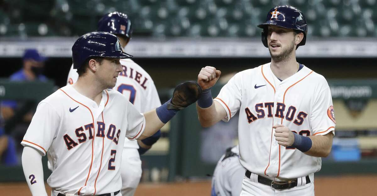 Houston Astros Kyle Tucker (30) celebrates his two-run home run with Alex Bregman (2) during the second inning of an MLB baseball game at Minute Maid Park, Thursday, September 17, 2020, in Houston.
