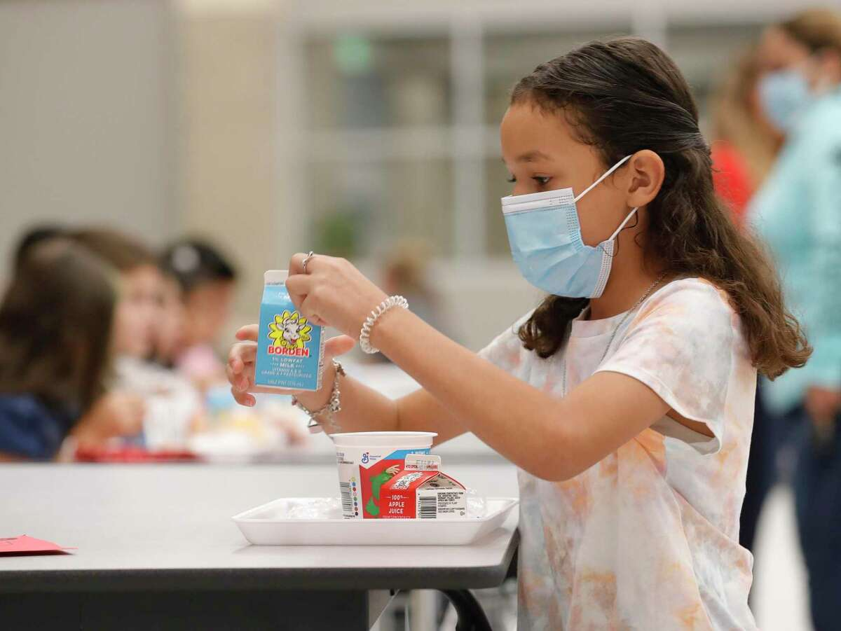 Solange Perrett eats breakfast before the first day of school at Conroe ISD's new Hope Elementary on Aug. 11. CISD reported 401 new student COVID-19 cases on Monday, which set a record for increases in daily cases for students in the district.