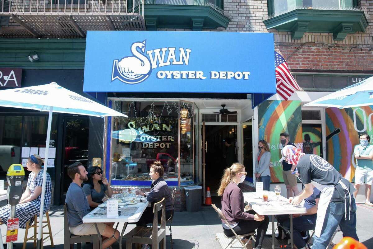 Diners eat outside at Swan Oyster Depot in San Francisco in August 2020.