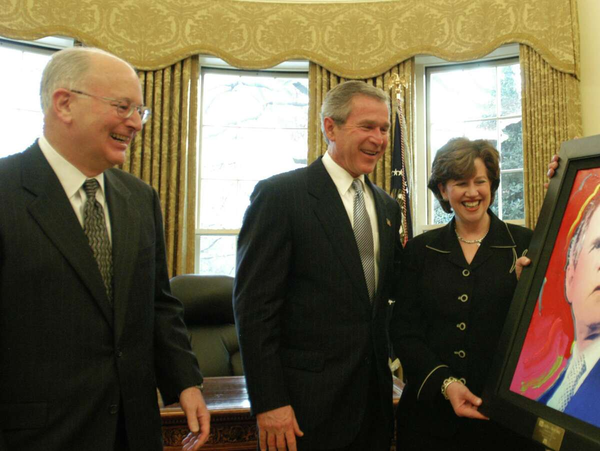 A+E Networks CEO Nick Davatzes, left, on Dec. 9, 2002, with President George W. Bush, and A&E executive Abbe Raven, in the Oval Office in Washington, D.C.